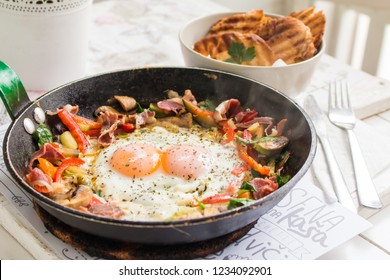 Over easy eggs cooked with vegetables and served with a toasted bread