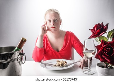 Over eating. Woman in red dress had too much to eat. Diet and eating healthy concept.