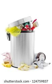 Over full trash can on white