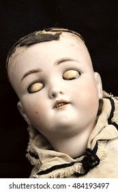 Over head view of a vintage spooky china doll face