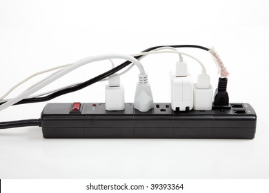 An over loaded black surge protector on a white background