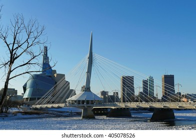Over the Red River. Winter view on Esplanade Riel bridge with Canadian Museum for Human Rights on the background. Winnipeg, Manitoba, Canada. 2014/11/22
