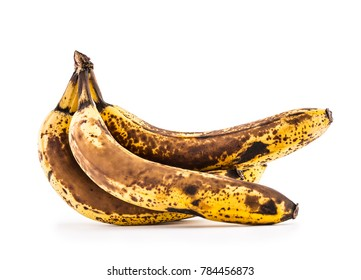 Over ripe bananas isolated on white with shadows.