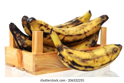 over ripe plantain banana in crate isolated on white background