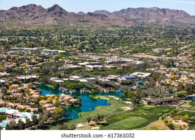Over Scottsdale, Arizona looking to the southwest at golf courses, resorts, luxury homes and Mummy Mountain