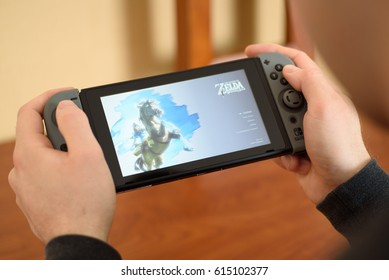 Over the shoulder shot of a man about to play Zelda Breath of the Wild on a Nintendo Switch console in Fogelsville, Pennsylvania, USA on March 19, 2017.