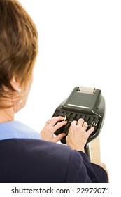 Over the shoulder view of a court reporter using stenography machine.  Isolated on white.