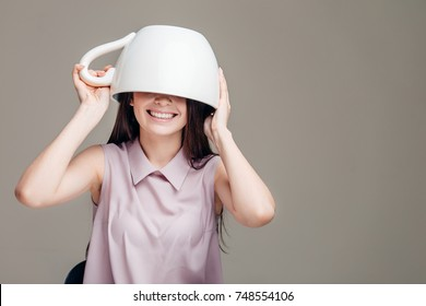 over size Cup on head of the woman like a hat.