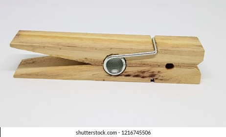 Over sized wooden clothes peg.