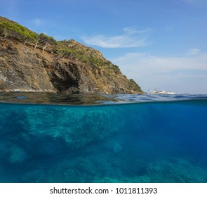 Over and under water surface, cliff with rocks underwater, Mediterranean sea, Cap Norfeu, Costa Brava, Spain, Cap de Creus, Girona, Catalonia