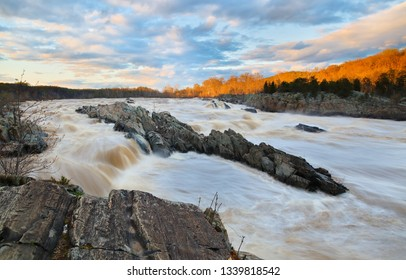 Over View of Rapids of Potomac River in Slow Motion at Sunset in Great Falls Park, Virginia. Great Falls Park is a small National Park Service site in Virginia near Washington DC, United States.