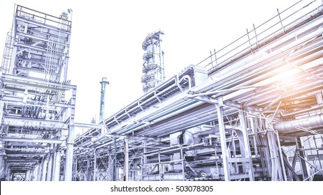 Overall view of an oil and gas refinery, pipelines and towers, heavy industry.