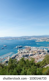 Overall view from top of the Rock of Gibraltar city, cruise port and marina, airport runway, Gibraltar Bay or Bay of Algeciras and the spanish town and port of La Linea.