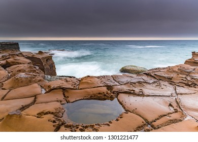 Overcast Coastal Seascape from Sandstone Headland - Capturing the sunrise from North Avoca Beach on the Central Coast, NSW, Australia.
