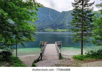 An overcast day over the green mountains surrounding Bohinj Lake near Bled, Slovenia