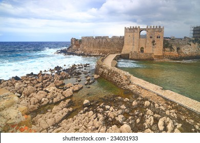 Overcast day and stormy sea waves against Venetian fortress of Methoni, Greece