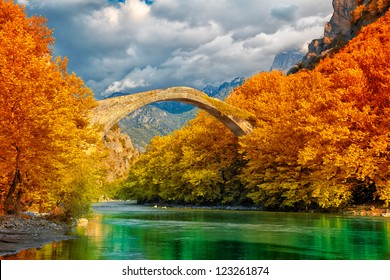 Overcast landscape of Konitsa bridge and Aoos River, Greece.