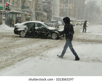 Overcast. Natural disasters winter, blizzard, heavy snow paralyzed city car roads, collapse. Snow covered cyclone