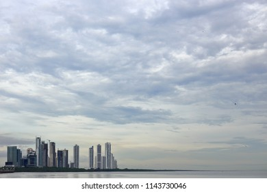 An overcast sky above the skyscrapers and apartment building in the south side of Panamá City, Panamá.