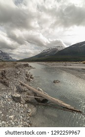 Overcast sky with Mountain and river view in the Canadian Rockies along the Icefields Parkway in Alberta, Canada.