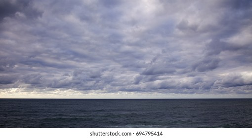 overcast sky over ocean, natural weather background