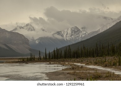 Overcast sky with river and Mountain view in the Canadian Rockies along the Icefields Parkway in Alberta, Canada.