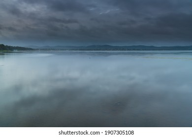 Overcast sunrise over the lake at Long Jetty on the Central Coast of NSW, Australia.