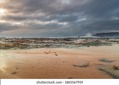 Overcast Sunrise Seascape from North Avoca Beach on the Central Coast, NSW, Australia.