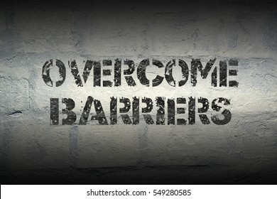 overcome barriers stencil print on the grunge white brick wall