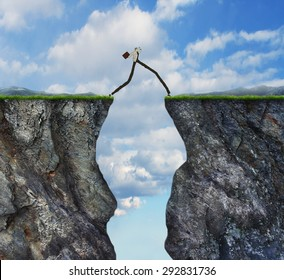 Overcoming obstacle concept as businessman with very long legs walking past through two high cliffs as success bridge metaphor to surmount obstruction solve problem