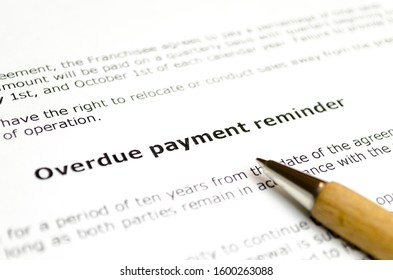 Overdue payment reminder with wooden pen