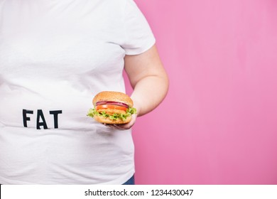 overeating, diet, glutton, junk food. fat obese woman with burger close up