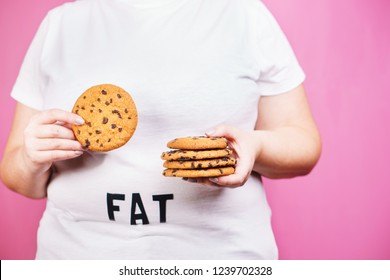overeating, diet, glutton, sugar addiction, diabetes, junk food. fat obese woman with stack of chocolate cookies