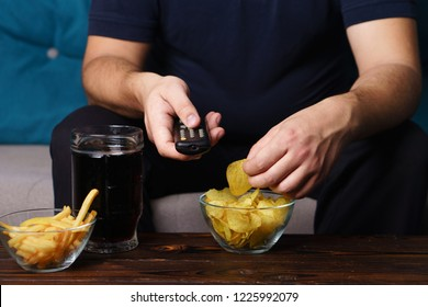 overeating, sedentary lifestyle, bad habits, food addiction, eating disorders. fat overweight man rest on the coach with tv remote, junk food and beer. depression, laziness alcohol addiction