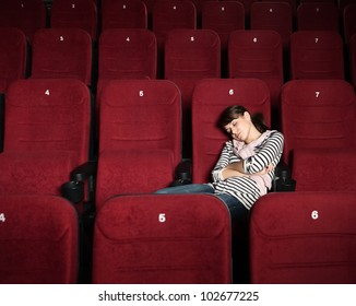 Overexhausted woman in the movie theater