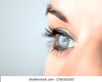 Overexposed close up of a young woman's right eye in side view