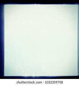 Overexposed square grainy medium format film frame. Film texture background