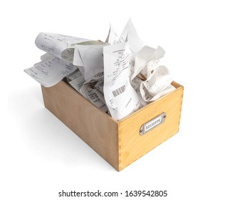 "Overfilled box of receipts for filing taxes and deductibles. Wooden storage box with ""Receipts"" label. Isolated on white."