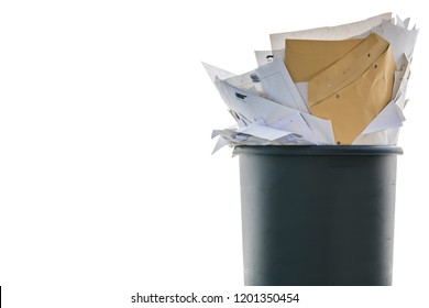 Overfilled recycle bin in front of white background