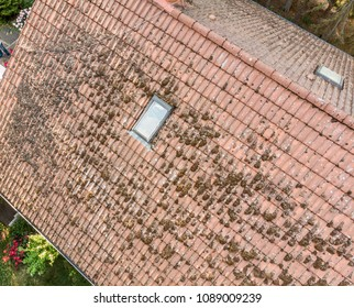 Overflight of the roof of a single-family house to check the condition of the roof tiles, aerial view made with drone