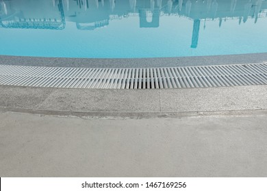 Overflow grate for the pool, overflow system, water drainage system at the edge of the pool bowl.