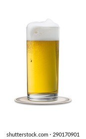 overflowing beer glass with on a beermat isolated on white background