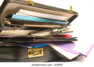 overflowing briefcase containing files