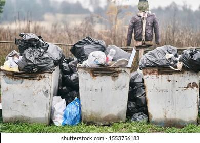 Overflowing Garbage Bins with Garbage Bags.