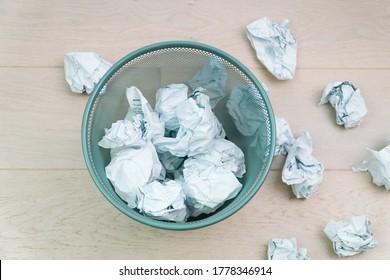 Overflowing waste paper in office garbage bin. Trash concept