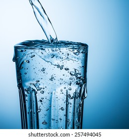 overflowing water in a glass