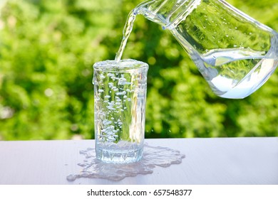 overflowing water in a glass Outdoors in summer