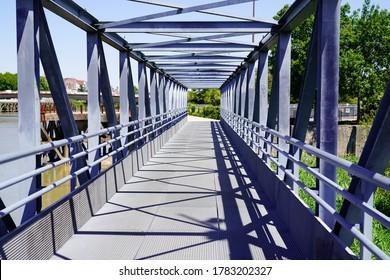 Overground Pedestrian Metal Crossing steel bridge walkway with Modern building perspective