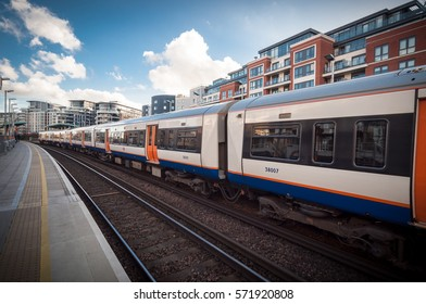 Overground Train passing, Imperial Wharf Station, TFL, London Railway Network, on a sunny day