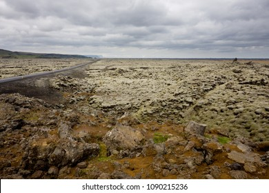 The overgrown lava fields in the south of Iceland stretch out as far as the eye can see. To the left you can see the icelandic main road 1.